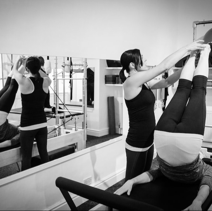 Feet in Straps on the Reformer